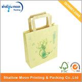 Bolsa de papel hecho a mano de encargo del nuevo diseño con la maneta (QY150299)