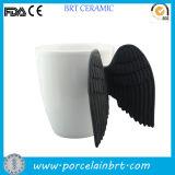 Tazza bianca di ceramica in bianco su ordinazione dell'ala di angelo