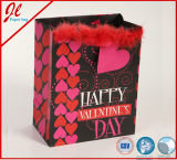 Le cadeau de Valentine met en sac des sacs de Valentine avec la poudre de Glister et l'étiquette de coup