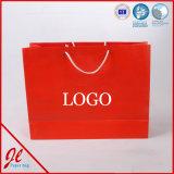 Bolsos de compras de encargo de las bolsas de papel del yute con la insignia para la ropa