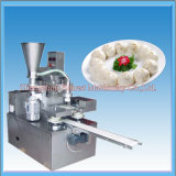 機械を形作る蒸気を発した詰められたパンMomoを作る高性能のパン