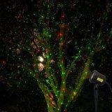 Освещение лазера зеленого цвета репроектора звезды выставки лазерного луча рождества красное с светлым датчиком