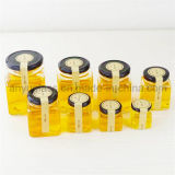 Опарник или бутылки пустого меда шестиугольника стеклянный с крышкой металла