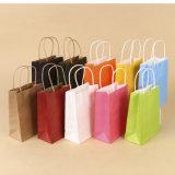 習慣はツイストハンドルが付いているクラフト紙のショッピング・バッグを印刷した