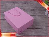 Saco de papel de compra da cor-de-rosa do saco de papel dos vestidos das mulheres
