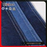 Мягкое сбывание джинсовой ткани хранят тканью, котор