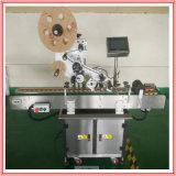 Étiqueteur automatique pour les bouteilles rondes