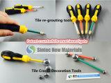 グラウトカラータイルの再グラウトを詰めるツールを復元するか、または変更するために着色剤のペンキにグラウトを詰めなさい