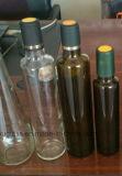 Botellas de cristal verdes olivas redondas con el color claro verde ambarino