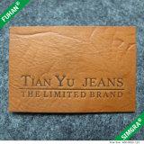 De in het groot Bruine In reliëf gemaakte Kledende Flarden van het Leer, de Flarden van het Etiket van de Jeans van het Leer van Pu
