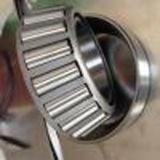 O rolamento de rolo afilado do baixo preço (32014) faz em Shandong