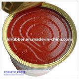 純粋なトマトのりの缶詰食品を詰める錫