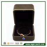 Caixa de jóia dourada feita sob encomenda da borda com tecla de pedra