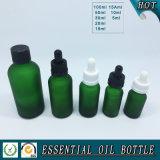 Botella de cristal verde helada para el petróleo esencial de los cosméticos con el casquillo de aluminio