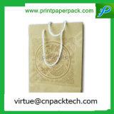 La coutume de luxe de mode colore le sac de achat de papier d'emballage avec la corde