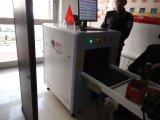 Segurança que seleciona a máquina At5030 da bagagem da raia X