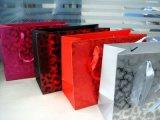 Fabrik-kundenspezifisches UVlackierenstempelndes rotes Gold-/Splitter-Papiereinkaufen/Geschenk-Beutel mit Griff,