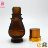 香水のための金帽子が付いている装飾的なガラスビン