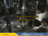 El tanque de la mezcla y de la disolución con el mezclador del disco de Cowles