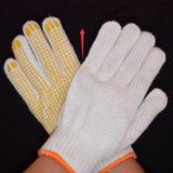 Поставленная точки деятельность хлопка связала перчатки при поставленный точки PVC