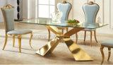 Insieme della sala da pranzo dell'oro di disegno moderno