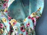 Le type de cru vêtx les robes florales de cercle plein profond de V pour des filles