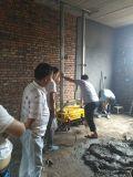 Mur de matériel de construction plâtrant la machine de rendu de mortier de la colle