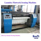 商業洗濯のアイロンをかける装置