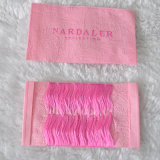 Fundo cor-de-rosa etiqueta tecida da tela para a roupa das meninas