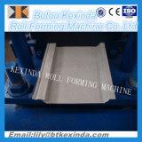 Roulis composé en aluminium de panneau en métal de voie de garage de mur formant la machine