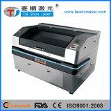 Macchina fotografica del CCD che posiziona la macchina per incidere del laser dell'autoadesivo di stampa