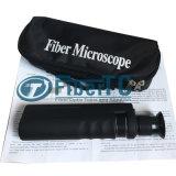 microscopes tenus dans la main de la fibre 400X