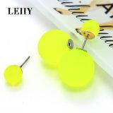 Серьги стержня шарика флуоресцирования желтые двойные, котор встали на сторону для женщин
