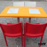 Table ronde à la surface solide ronde 2 sièges