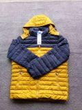 Bens no estoque, dos vestuários revestimentos conservados em estoque para baixo, revestimentos do inverno do homem