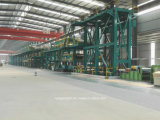 La fuente pintó las bobinas de acero que cubrían la cadena de producción fábrica