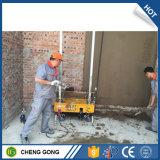 Muro di mattoni concreto di costruzione che intonaca la macchina dello stucco della rappresentazione
