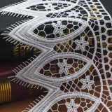 Tessuto all'ingrosso poco costoso lavorato a maglia del merletto di Guangzhou del merletto del fiore del broccato
