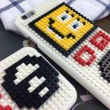 La cara sonriente de Corea Gd bloquea el caso móvil creativo del teléfono celular ensamblado manualmente