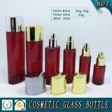 Rote farbige Glaskosmetik Flasche und Kosmetik-Glassahneglas