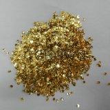 Flocos dourados que brilham o pigmento do pó