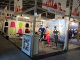 Les circuits de gymnastique de polyester de filles vendent l'usure en gros de gymnastique