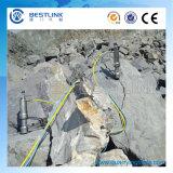 Roca de la energía grande y divisor hidráulico concreto con el motor diesel