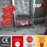 Muro de cimento da construção que emplastra o equipamento da maquinaria