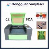 Machine de laser pour des non-métaux de gravure de découpage recherchant des allumeurs d'agents