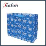 結婚式の休日高いOEMはリボンロープが付いている紙袋を設計する