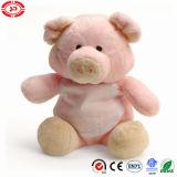 Peluche mignonne rose bourrée de contact doux de porc reposant le jouet porcin