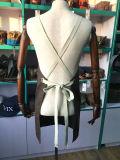 A cruz para trás encerou o avental do trabalho da lona para mulheres
