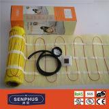 Под системой циновки кабеля топления плитки