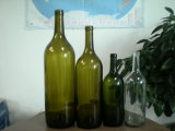 Bottiglie di vetro placcate dell'oro